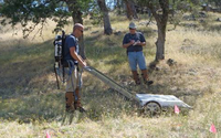 Production contractor field personnel collecting cued data using the TEMTADS 2x2 array.